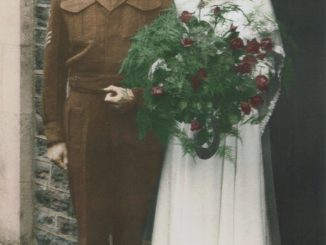 A wartime wedding photo of a young man in uniform and a woman in a wedding dress with a huge bunch of flowers.