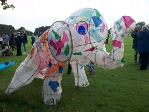A colourful elephant lantern made of tissue paper and willow on grass