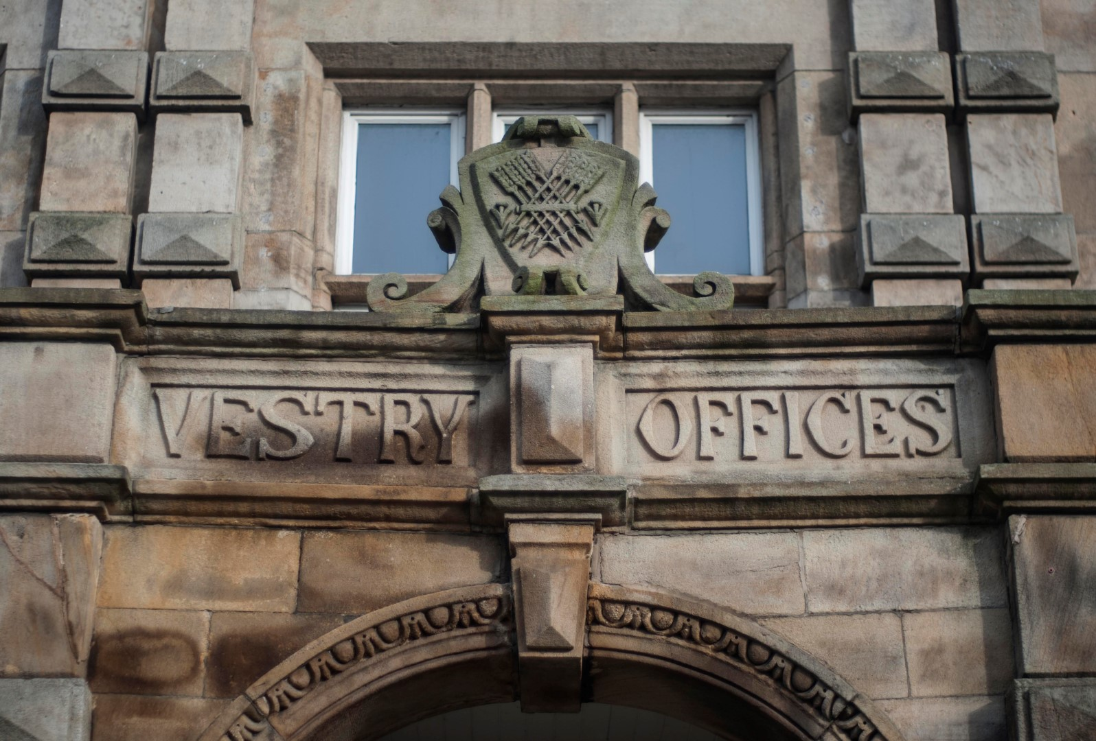 A close up photo of the sign above the door at Vestry Hall. Says: Vestry Offices