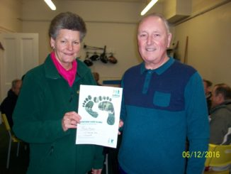 Trevor and a Pitsmoor Health Walk volunteer holding Trevor's Volunteer walk leader certificate.
