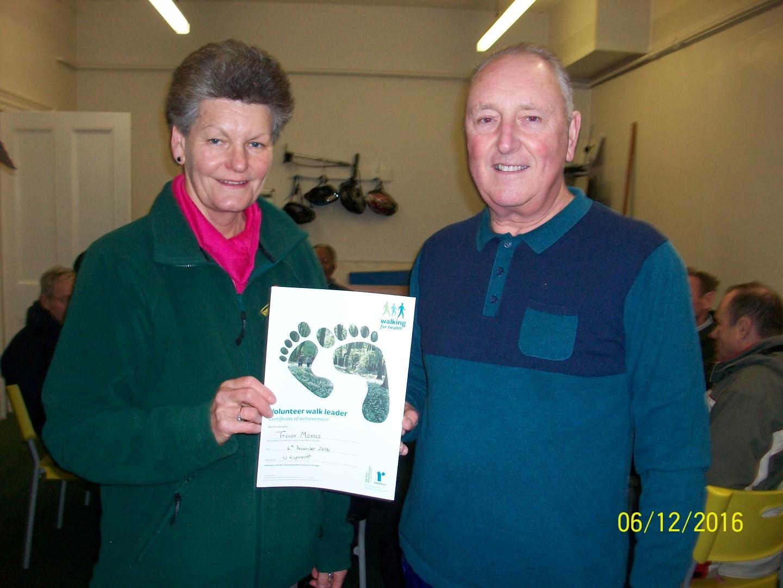 Trevor and a Pitsmoor Health Walk volunteer holding Trevor's Volunteer walk leader certificate.