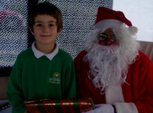 Father Christmas and an Owler Brook School's student.