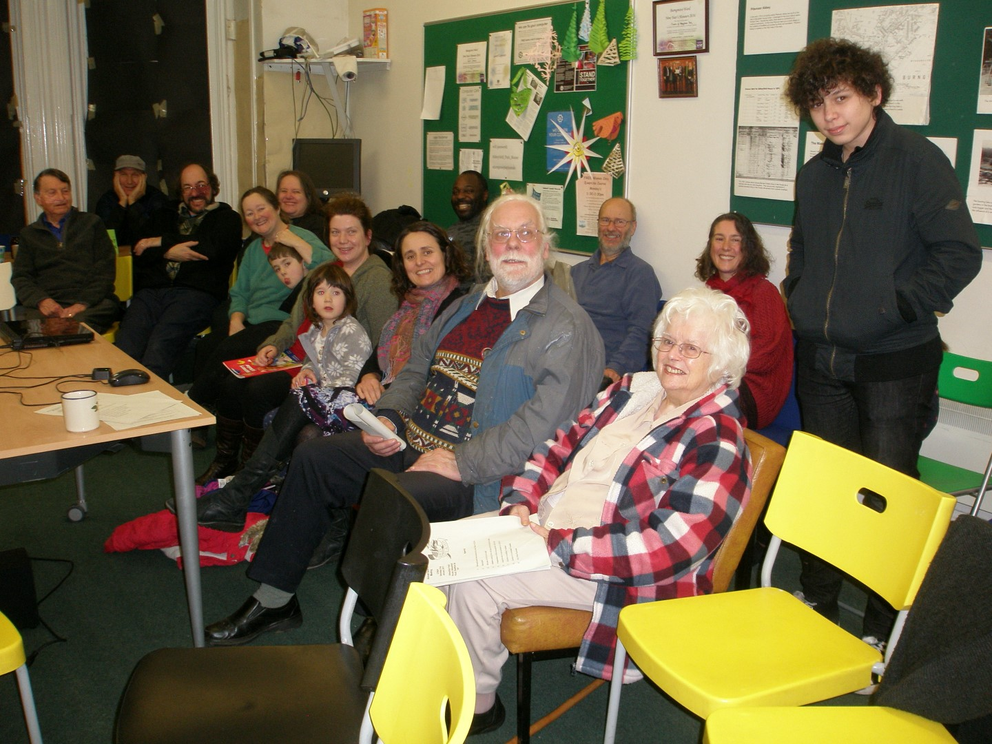 Green City Action and Burngreave Messenger volunteers sitting in the community room in Abbeyfield Park house.