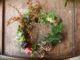 A Christmas wreath on a wooden table.