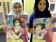 Two children with their artwork (Snow White)