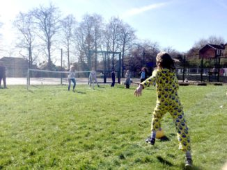 Children playing football in pyjamas on a winter day