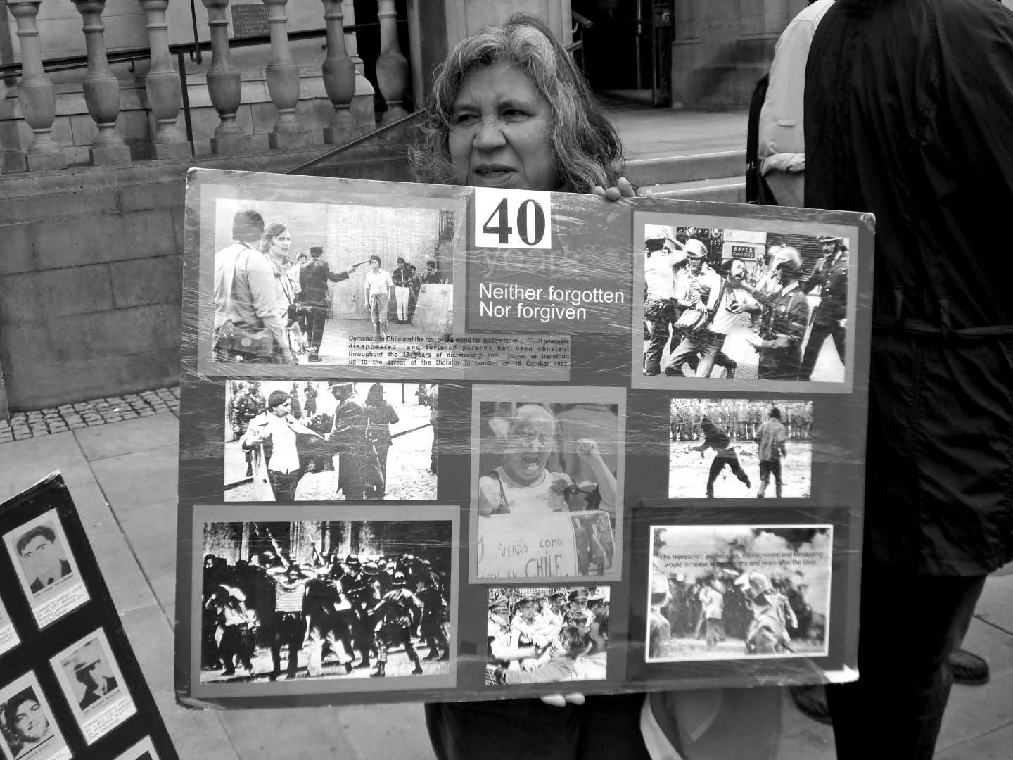 Isilda Lang remembering the disappeared with a graphic placard on the town hall steps