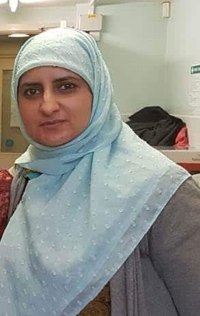 a picture of Shafaz, she is wearing a light blue headscarf.