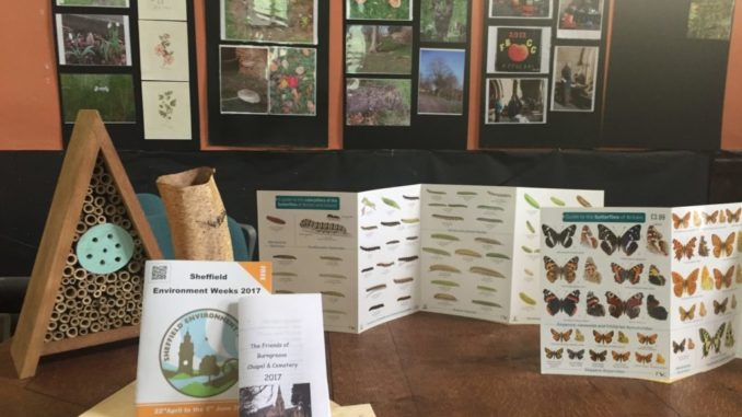 In the photo we can see a table, with four flyers with information of flora and fauna, in the background we can see photos of the exhibition.