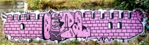 Pink graffiti of a castle wall with a knight hidden in the word 'Izal'
