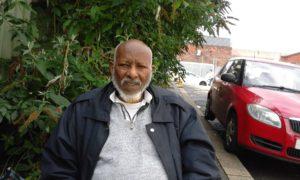 Photo of old somali man looking at the camera