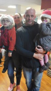 Man and children at the TARA meeting