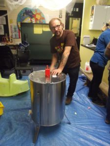 Patrick spins the extractor.