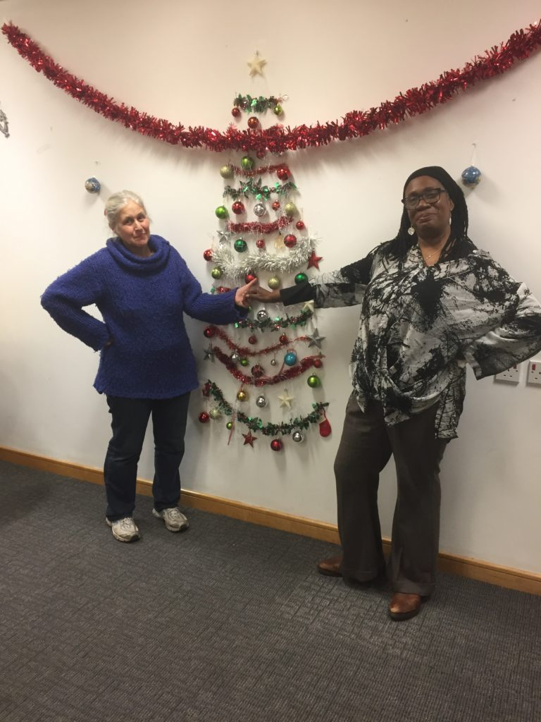 Erica and Jill get creative with the Library Christmas tree.