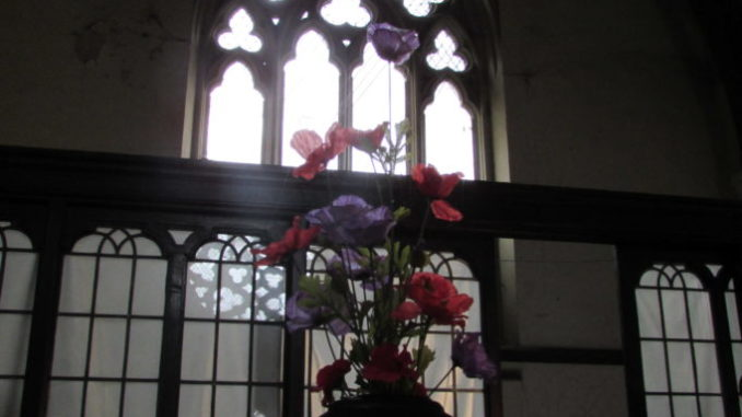 Cemetery window and flowers