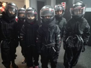 A group prepared for go-karting with helmets even if they were a little nervous. See the Messenger website for full details of these adventures.