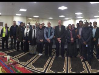 Rock members visit Al Rahman Mosque
