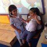 Children listening to heartbeats