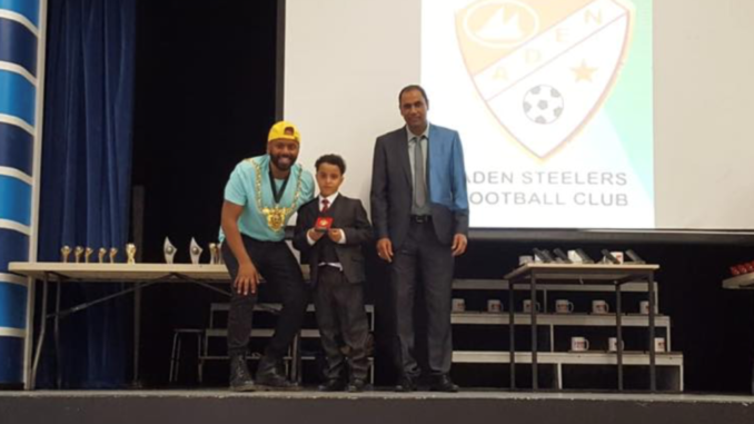 Musa Sami Musa receiving the award for most improved player in the under 10s