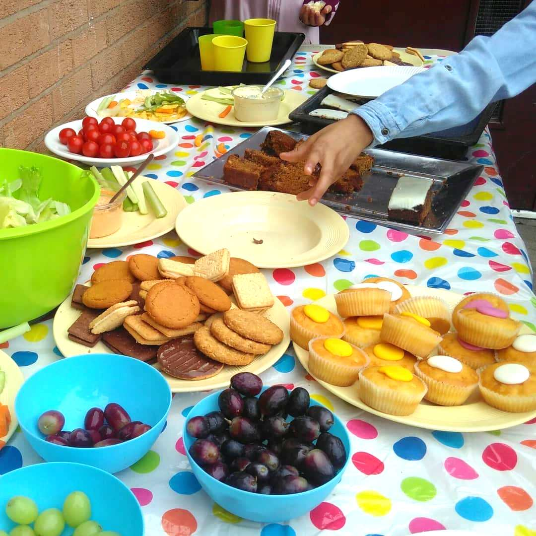 Buffet of biscuits, buns and fruit.