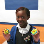 Pupil with her own decorated biscuits