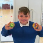 Pupil with his own decorated biscuits