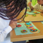 Pupil decorating biscuits