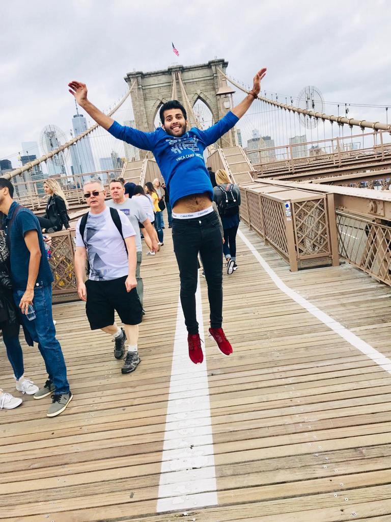 Adnan Hussain leaping on suspension bridge