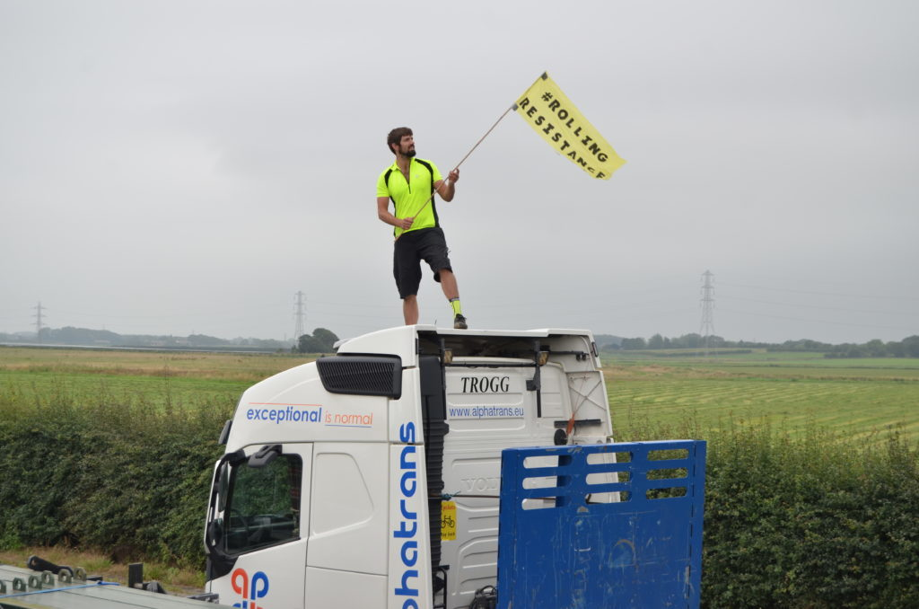 Simon Roscoe protesting on top of a truck