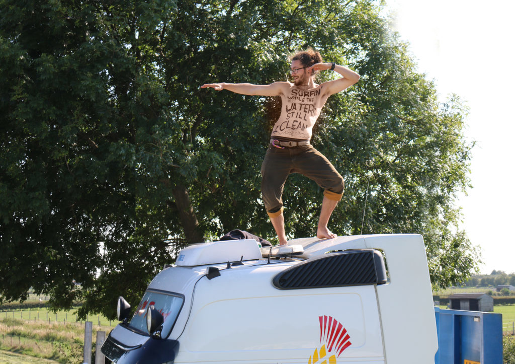 Simon Roscoe Surfing on top of a truck