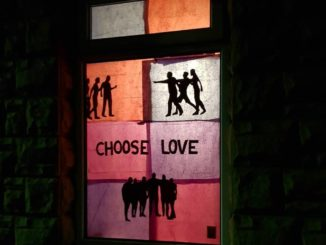 'choose love' in a window