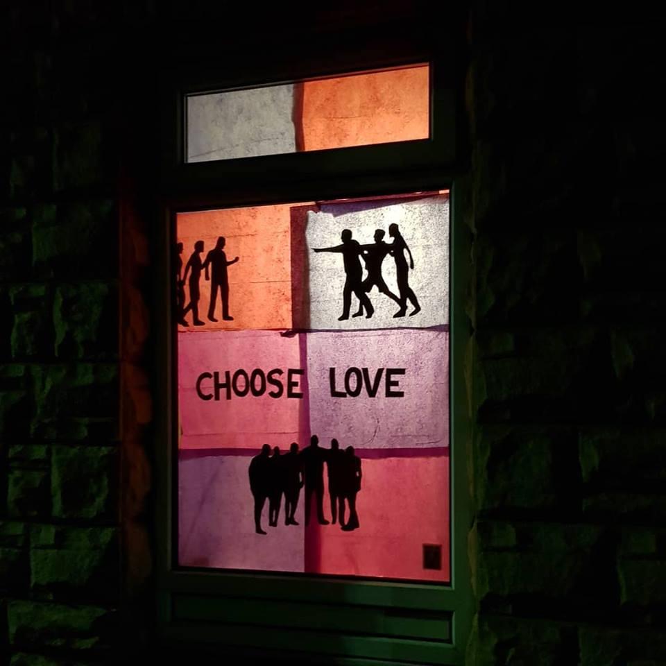 'choose love' in a window