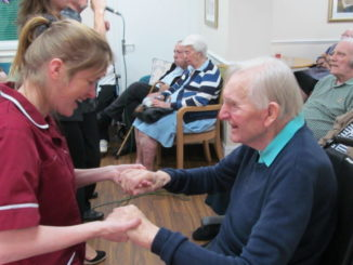 Staff member and resident celebrate