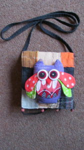 Lost property. Little handbag with a picture of an owl on the front
