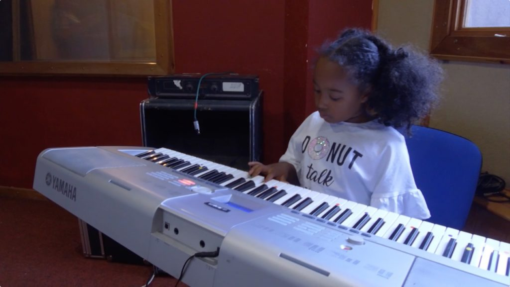 Child plays the keyboards
