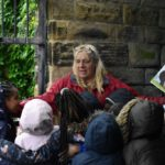 Children gather at the Abbeyfield Park shelter to listen to a story.