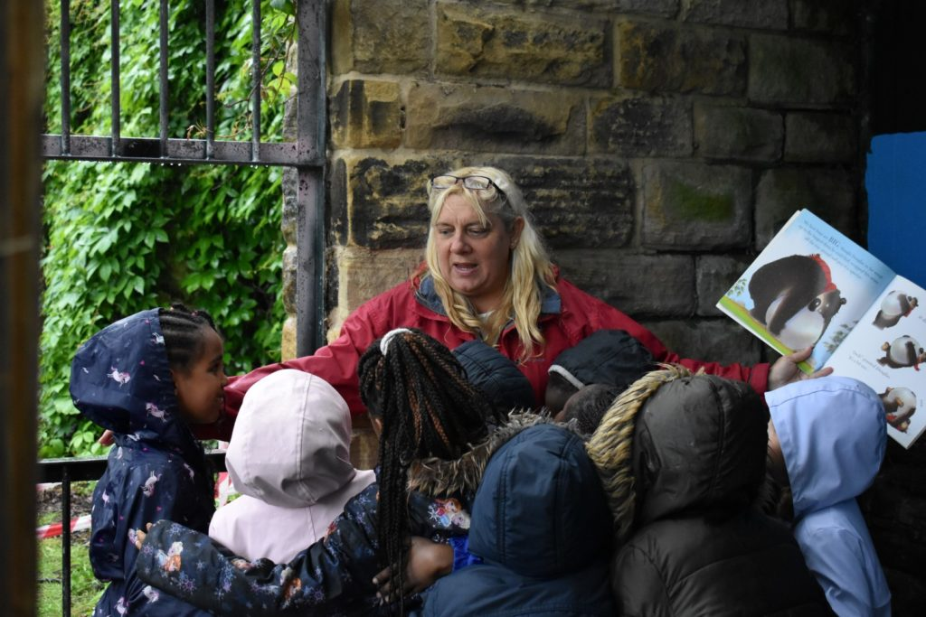 Abbeyfield shelter – reading a story