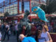 Climate Strike campaigners carry Inflatable dinosaur and kingfisher lantern to Barkers Pool.
