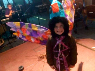 Child in a lantern costume.
