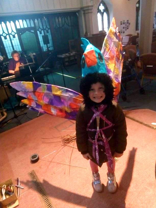 Child in a lantern costume.