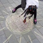 Girl chalks the sun