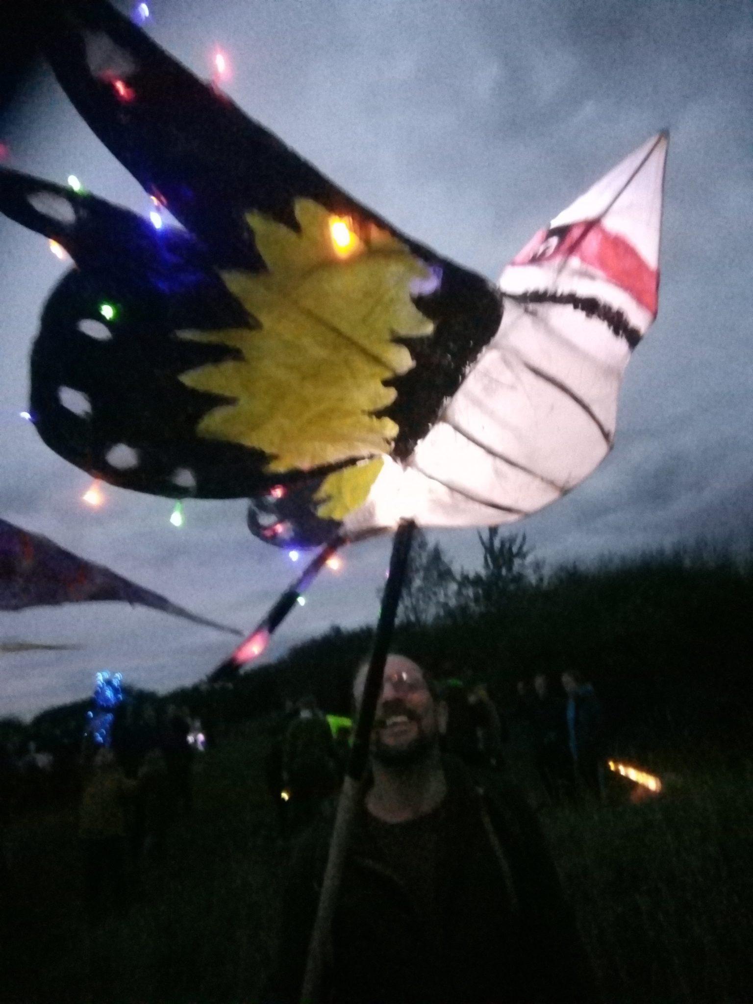 Goldfinch lantern held high