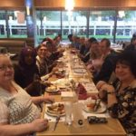 Library volunteers celebrate with a meal meal