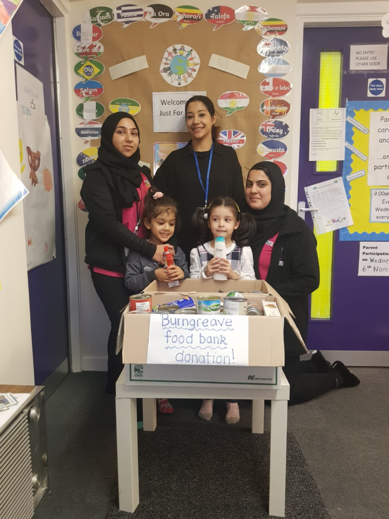 Team and children with a food bank donation box