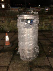 Shrink-wrapped bin Nico Hall