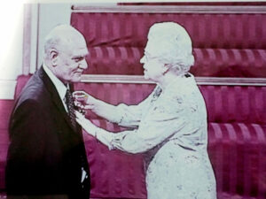 Mr Iqbal receiving his MBE from Her Majesty the Queen.