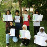 Pye Bank children with their Eid-Al-Fitr explanations.