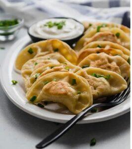 Savoury mushroom Pierogi on a plate.