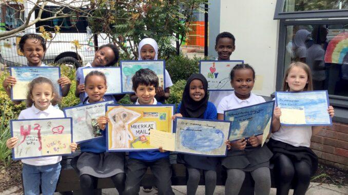 Pye Bank children showing their artwork.