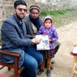 Zia Khan (left) on a visit to the Kotli region of Kashmir in February 2020.